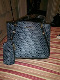 monogrammed black and gray Michael Kors leather to Austell, 30106