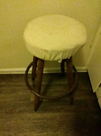 brown wooden base white padded chair