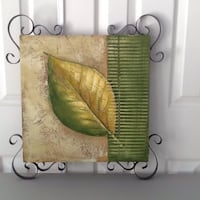green and brown leaf design painting board
