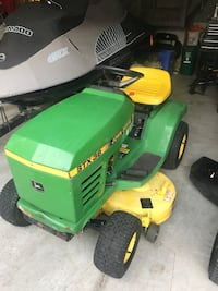 Green and yellow john deere ride on lawn mower Whitby, L1R 2L3