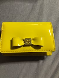 yellow patent leather bow accent wallet