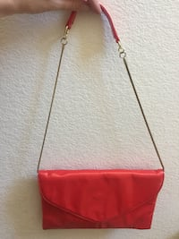 red leather crossbody bag with silver chain link bracelet Las Vegas, 89145