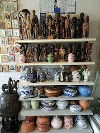 assorted wooden statues and ceramic