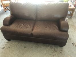Brown leather couch with wooden boxed legs