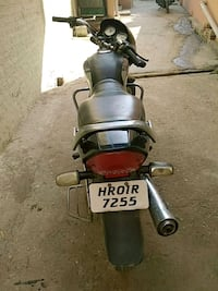 black and gray motor scooter Tolan Wali, 133205