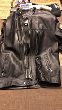 This is a effe uomo italian black leather jacket . men's large. purchased in italy while there. it's never been worn but yearly conditioning of the leather has kept it in pristine condition. price is not negotiable because it's worth three times what i'm