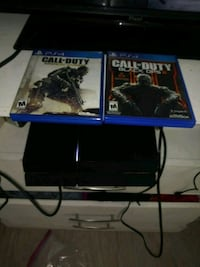 black Sony PS4 with game cases Colton, 92324