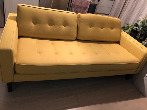 Couch in mustard yellow. Hardly used without slipcover and it's thoroughly cleaned. Few months old.