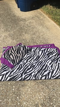 white and black zebra print blanket and pillow cover