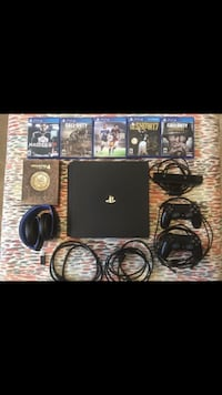 black Sony PS3 slim console with game cases Mc Lean, 22102
