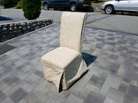 Cream colored fabric padded chair North Vancouver, V7N 1E8
