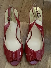 pair of red patent leather sling-back heeled sanda