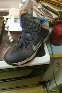 pair of black-and-blue Nike basketball shoes Ladson, 29456