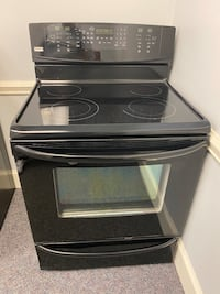 BLACK KENMORE GLASS TOP STOVE W/CONVECTION 4 month warranty financing
