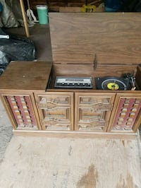 Antique record player with cabinet