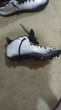 white and black Under Armour football cleat