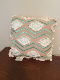 beige and white throw pillow