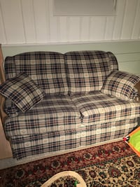 White,red, and black plaid fabric loveseat