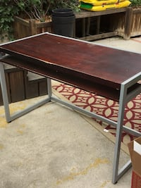 brown wooden table with gray metal base Los Angeles, 90041