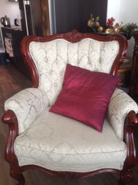 white and red floral fabric sofa chair Toronto, M4Y 2B6