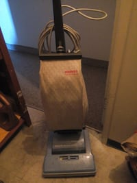 gray and black upright vacuum cleaner 2472 km
