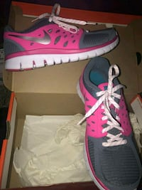 pair of pink-and-gray Nike running shoes Chandler, 85226