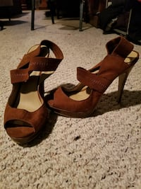 pair of brown suede ankle-strap pee-toe heeled sandals