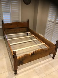 Pine wood solid bed double size. Delivery available on cost of gas
