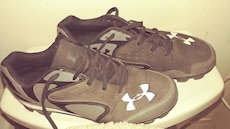 pair of black-and-white Under Armour cleats