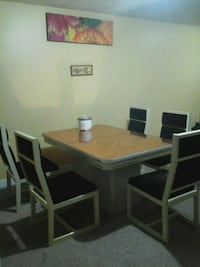 rectangular brown wooden table with six chairs dining set Calgary, T3J 4R2
