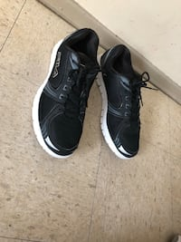 Pair of black-and-white Fila sneakers size 12