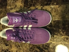 Pair of purple adidas low-top sneakers