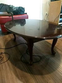 round brown wooden pedestal table Ossining, 10562