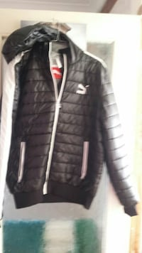 black and white PUMA zip-up bubble jacket