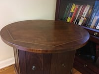 Round brown wooden table with cabinet North Charleston, 29418