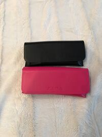 two red and black leather wallets 778 km