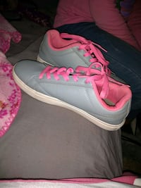 pair of gray-and-pink Nike running shoes East Saint Louis, 62204