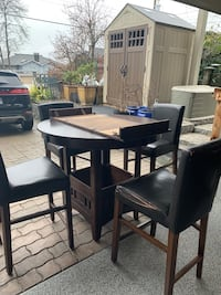 Bar height wooden round table with extension piece plus 4 bar stools North Vancouver, V7M 1K7