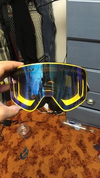 yellow and blue framed snowboard goggles Edmonton
