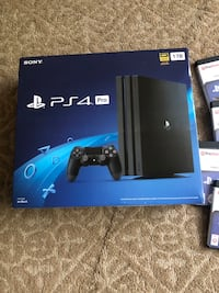 New ps4 pro sealed and 7 games