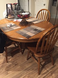 Round brown wooden table with four chairs dining set Brookhaven, 11719