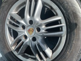 Rims from a Cayenne Porsche 4 rims. Tires are unusable. One is missing the middle logo.