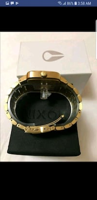 round gold-colored analog watch with link bracelet 3153 km