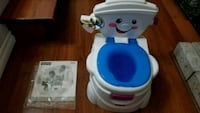 white and blue Fisher-Price potty trainer Langley Township, V4W 3B8