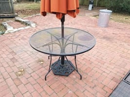 Outdoor table and umbrella stand