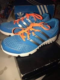 pair of blue-and-white Adidas running shoes New York, 10457