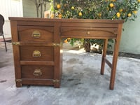 Brown wooden desk with drawer