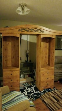 brown wooden cabinet with glass shelves and lights