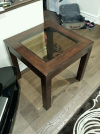 square brown wooden framed glass top table Toronto, M9P 1N7