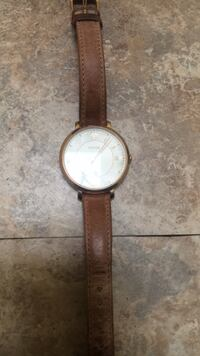 Round gold analog watch with brown leather strap Baltimore
